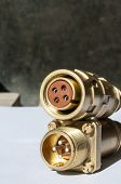 Brass Four-pin Electrical Connector. Specialized Connections For Especially Critical Nodes. poster