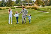 Soldier Walking With Kids And Wife. Holding Hands, Happy Reunion Of Father And His Family. Walk On T poster