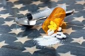 Front View Of Opioid Pain Killer Tablets With Spoon And Syringe On Rustic Usa Flag In Background For poster