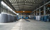 Modern Large Factory Warehouse Interior With Some Goods Concrete Pipes. Industrial Production Of Cem poster