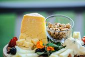 Cheese Parmigiano, Nuts Cashew, Strawberry And Blackberries poster