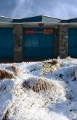 stock photo of tuck-shop  - a closed ice cream shop front on the seaside in ireland on a cold winters day - JPG