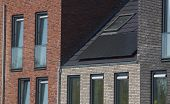 Solar Panels For Durable Energy On The Roof Of A New Build House On A Summer Day / Save Money With P poster