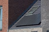 Solar Panels For Durable Energy On The Roof Of A New Build House On A Summer Day / Photovoltaics On  poster