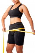 picture of tape-measure  - Woman dressed in grey measuring size of thigh healthy lifestyles weightloss concept isolated - JPG