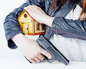 Armed Woman With A Gun In His Hand And A Toy House Under His Arm. The Right Of Armed Protection Of P poster