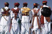 foto of rajasthani  - Men in traditional Rajasthani dress with shields and axes - JPG
