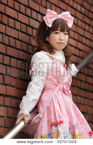 japanese lolita cosplay posing on stairs