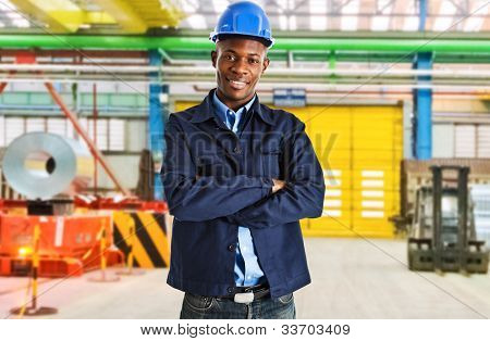 Smiling engineer at work in a factory