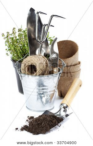 garden tools (shovel,  rake, pruner, cord and peat pots ) over white