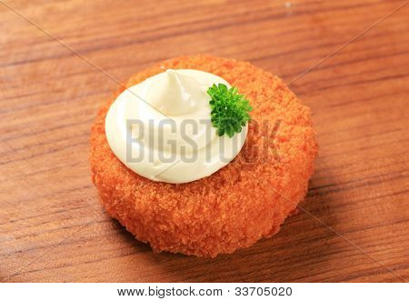 Fried ermine cheese on a kitchen board