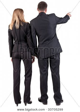 Back view of pointing business team. young couple (man and woman). Beautiful girl and guy in suit together. Rear view people collection.  backside view of person.  Isolated over white background