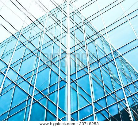 wide angle view to blue texture of  light glass buildings in business center