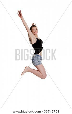 Teen girl jumping for joy, isolated on white background