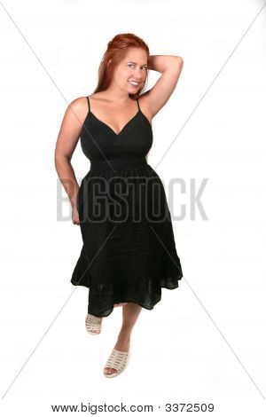 Red Haired Plus Size Model Posing On White Background
