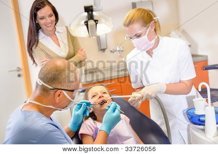 Little patient at the dentist have teeth checkup stomatology clinic