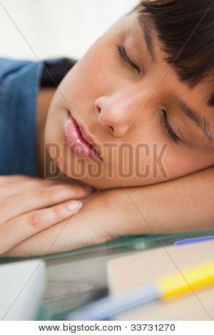 Close-up of a cute student sleeping on her desk