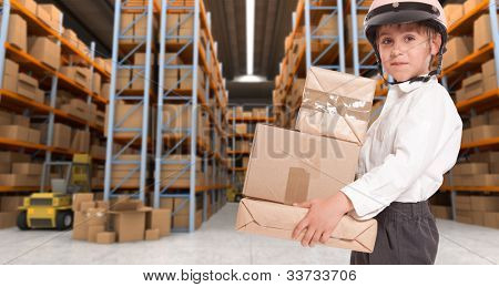 Child wearing a motorbike helmet carrying parcels in a transportation warehouse
