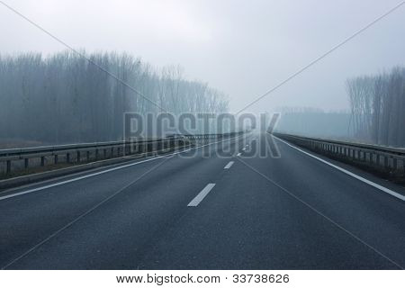 Long road on a foggy day