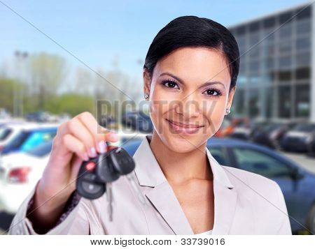 Woman with a Car keys. Transportation background.