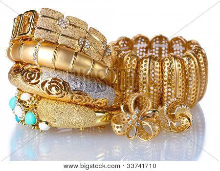 Beautiful golden bracelets isolated on white