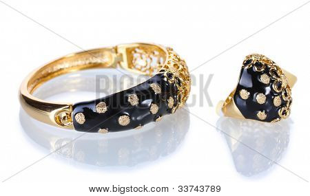 Beautiful golden bracelet and ring isolated on white