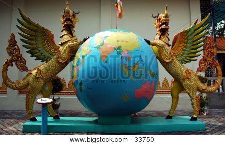 Phoenix Beside A Globe, Taken In A Burmese Temple