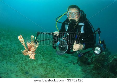 Scuba Diver photographer and Lionfish