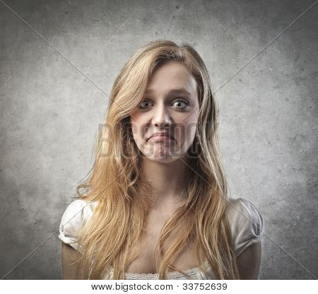 Young woman with sad grimace