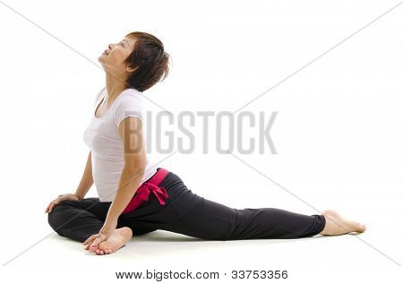Mature Asian woman in yoga, isolated on white