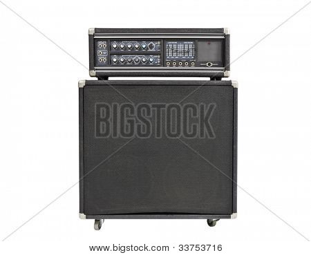 Vintage rock and roll bass amplifier isolated on white.