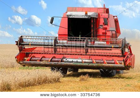 Combine harvesting wheat.