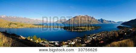 Panoramic view of the Frankton arm, The remarkables, Lake Wakatipu and Queenstown at dawn in the fall