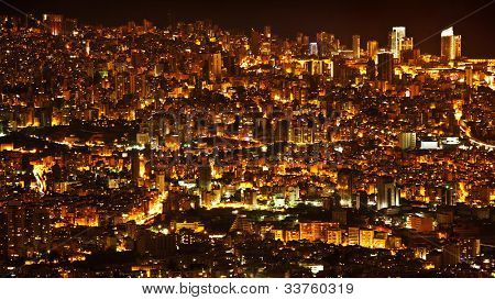 Night city background, beautiful urban cityscape, Beirut with street lights, high buildings and skyscrapers,panoramic dark town pattern, Middle East , Lebanon