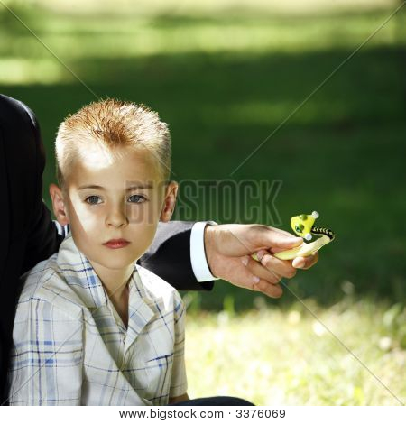 Young Blond Boy In The Nature