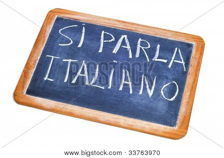 sentence si parla italiano, italian is spoken, written on a chalkboard