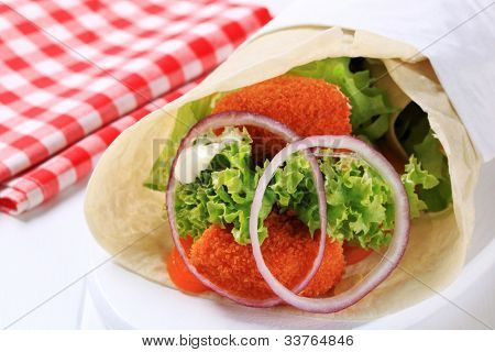Fried ermine cheese  with vegetables in cabbage leaf
