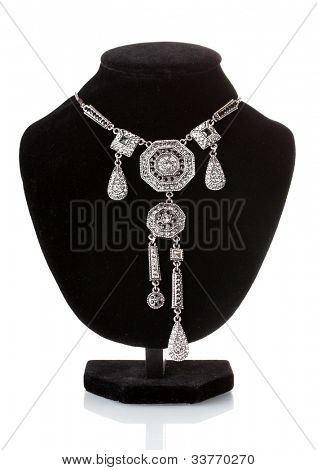 Silver necklace on black mannequin isolated on white