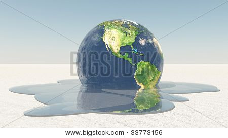 Earth melting into water on white surface