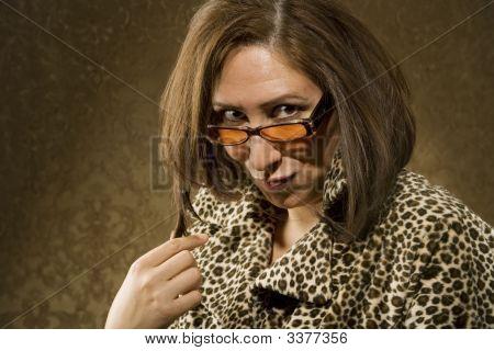 Hispanic Woman With Sunglasses Twists Her Hair