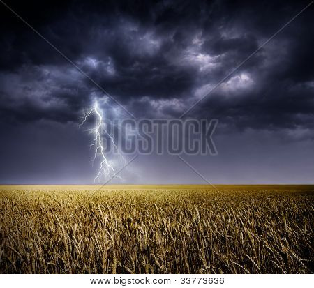 Dark stormy clouds over a field