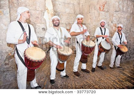 JERUSALEM, ISRAEL - APRIL 26: Israeli famous musicians at the Zion gate in the old part Jeruslalem on a jewish holiday Israel's 64th Independence Day on April 26, 2012 in Jerusalem, Israel