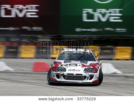 KUALA LUMPUR - MAY 19: Japan's Max Orido (RSR) slides as he turns during the Formula Drift 2012 Asia Round 1 on May 19, 2012 in Speedcity, Malaysia. He emerged second in this competition.