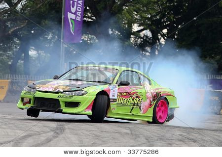 KUALA LUMPUR - MAY 19: Malaysia's drifter D-Wan of Team Westlake Tyres slides on 3 wheels in a practice run at the Formula Drift 2012 Asia Round 1 on May 19, 2012 in Speedcity, Kuala Lumpur, Malaysia.