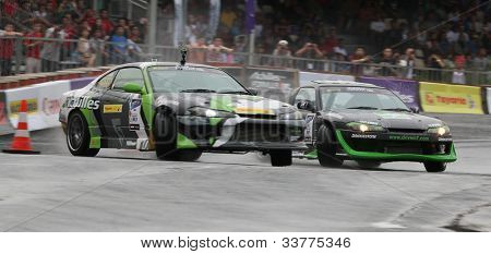 KUALA LUMPUR - MAY 20: Tengku Djan (right) chases Emmanuel Armandio (left) during the Formula Drift 2012 Asia Round 1 on May 20, 2012 in Speedcity, Malaysia. Tengku Djan won third place in this event.
