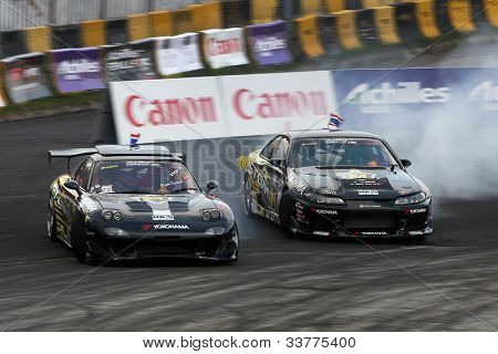 KUALA LUMPUR - MAY 19: Thailand's Nattawoot (left) and Saranon drift in tandem at the Nations Cup competition during the Formula Drift 2012 Asia Round 1 on May 19, 2012 in Speedcity, Malaysia.