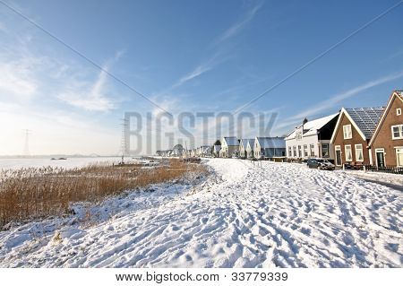 Traditional snowy dutch village Durgerdam in the Netherlands in winter
