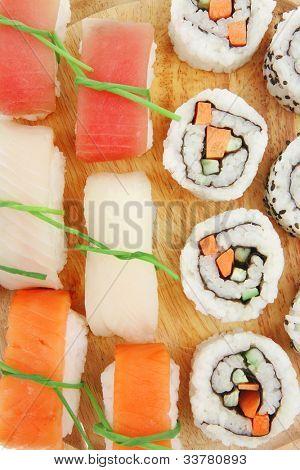 Maki and Nigiri Sushi - California Roll with Avocado and Salmon, Cream Cheese and Raw Salmon inside with nigiri topped raw Salmon Tuna and Eel . isolated over white background