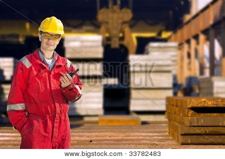 Portrait of a skinny operator in front of a steel mill