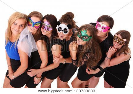 A portrait of seven girlfriends in carnival masks smiling over white background